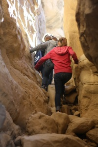 Photo by The Catalyst Scholars climb the steep crevices of Chaco Canyon on last year's Freshman and Sophomore camping trip.