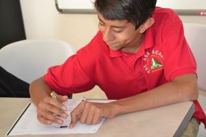 Photo by Mario XXX Middle School student, xxxx xxxx, works on a project in xxx class.