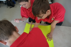 Photo by Mario Andreatta Middle School students work on a project in math class.