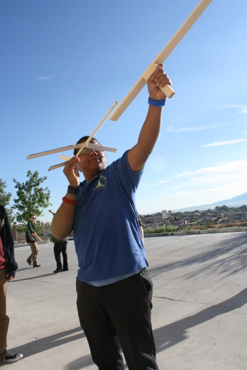 """Photo by The Catalyst Junior Marcus Carlile prepares to launch his glider during Monday's Aerospace competition. R.Kelly's """"I Believe I can Fly,"""" played during the competition."""