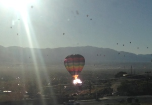 Photo by Greg Abernathy of The Catalyst A balloon catches on fire after hitting powerlines near the ASK Academy in Rio Rancho this morning. This photo was shot with a scholar's cell phone camera from an upstairs classroom seconds after the crash.