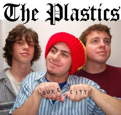 Divett, middle, in his band The Plastics.