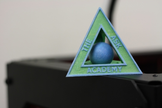 ASK Scholars copy the school's logo as 3D gifts for STEM partners in the community.