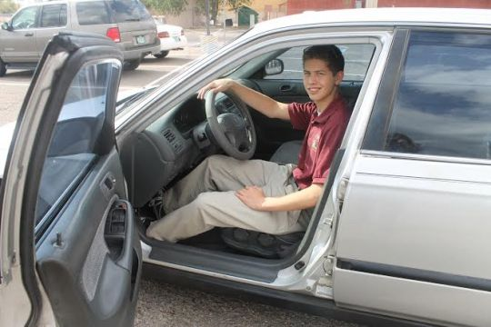 Photo By Hannah Worker  Brandon Battelle in his newly purchased Honda Civic. He purchased it with the $3,000 he won for having perfect attendance.