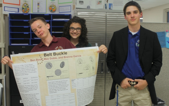 Photo by Hannah Worker -Scholars show off the poster they presented for ASK's first annual PBL Night.