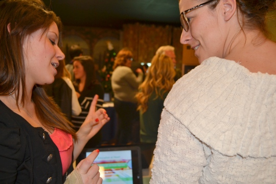 Photo by Mario Andreatta Senior Kyra Odenbach discusses her RIA project with Ms. Slavnic at last year's ReCon.