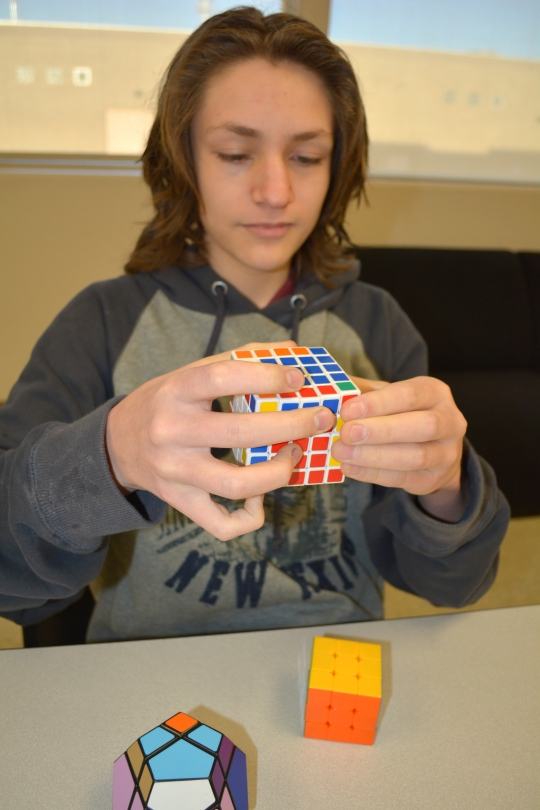 Photo by The Catalyst  Sophomore Connor Montoya works to solve the puzzle of his