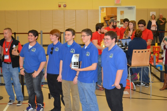 From left, Lonnie Hedrick, Robert Dansro, John Dansro, Brandon Battelle,  and Ryan Cooper pose with their trophy at a VEX Robotics competition last weekend.