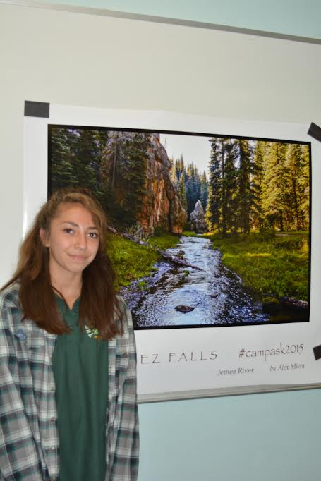 Photo by Paige Fairchild// Freshmen Alex Miera stands in front of her winning Instagram photo, which has been turned into a poster to be hung in the new school.
