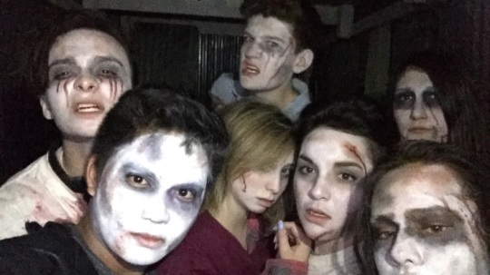 /Photo by Mario Andreatta/ Model UN Members dressed in their zombie characters while working at the haunted farm.