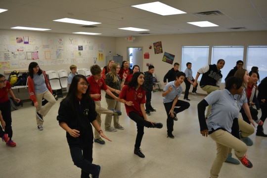 "Photo by Paige Farichild Scholars taught their classmates how to do the 1970's dance ""The Hustle"""