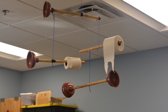 Physics Scholars created used math to create balanced mobiles out of various objects.