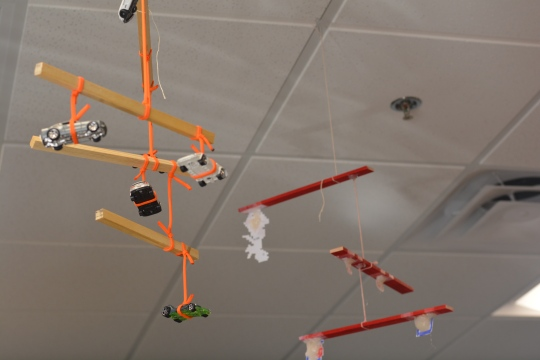 Photo by Emily Romero Physics Scholars created used math to create balanced mobiles out of various objects.
