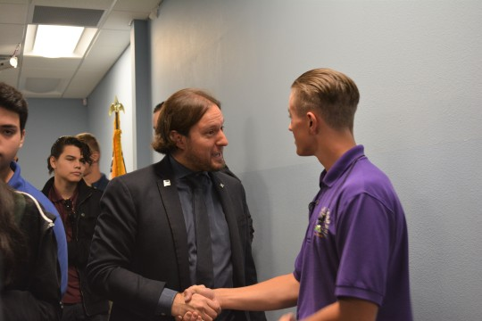 Ruszkowski shakes senior Charlie Erickson's hand during the high school assembly.